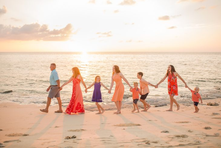 Large family of 8 on the beach at sunset in Yomitan, Okinawa Japan by Alison Bell Photographer