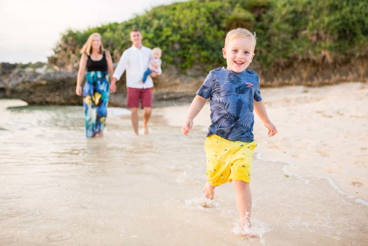 Fun, stress free family photos with Alison Bell, Photographer on the beach in Okinawa, Japan.