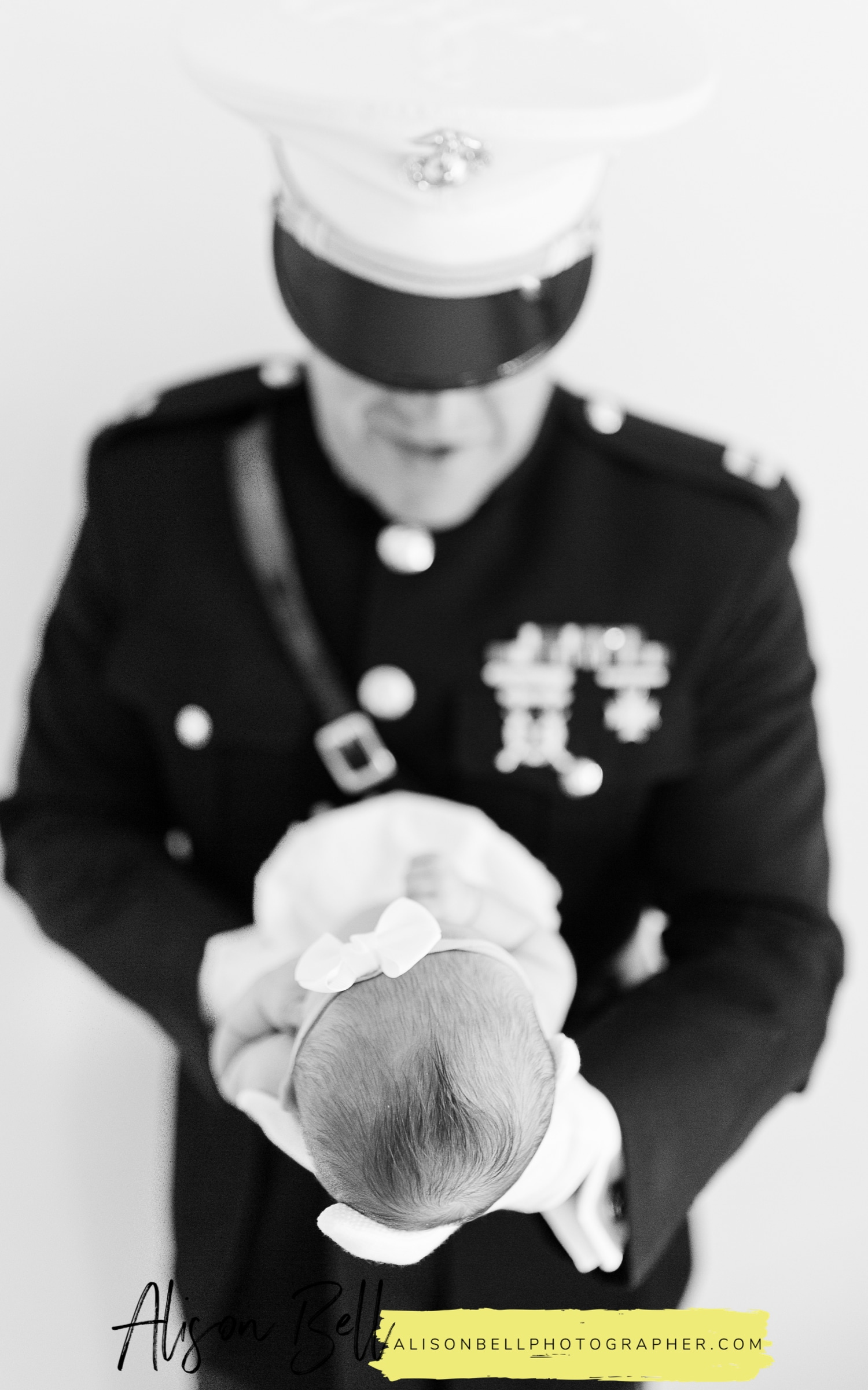 Lifestyle newborn photography in home with USMC dress blues. Officer Blues by Alison Bell, Photographer alisonbellphotographer.com